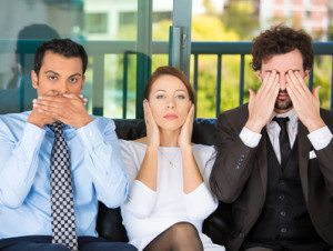 Businesspeople imitating see, hear, speak no evil concept