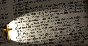 a close up of Ephesians 2:8 lit up by the cross, King James version