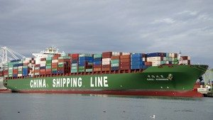 OAKLAND, CA - DECEMBER 08, 2014: China Shipping Lines (CSCL) Cargo Ship SUMMER docked at the Port of Oakland. CSCL, based in Shanghai, China, it is now the eighth largest container shipping company.