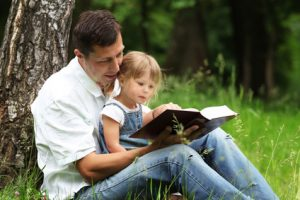 father and daughter reads the Bible